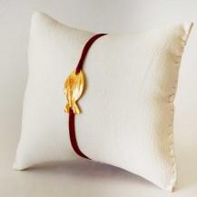 Bracelet rouge bordeau et poisson en laiton doré